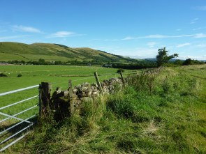 Looking back at Kirknewton. The first stretch was a gentle uphill farm track.
